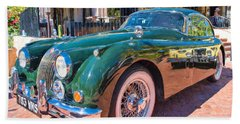 Beach Towel featuring the photograph Jaguar Xk Classic by Dan McManus