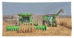 John Deere Combine Picking Corn Followed By Tractor And Grain Cart Beach Towel