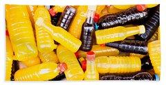 Juice Bottles Beach Towel by Tom Gowanlock