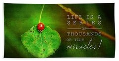 Ladybug On Leaf Thousand Miracles Quote Beach Towel