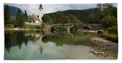 Lake Bohinj With Church In Slovenia Beach Towel by IPics Photography