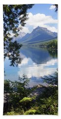 Lake Mcdlonald Through The Trees Glacier National Park Beach Towel