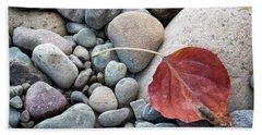 Leaf On River Rocks Beach Towel