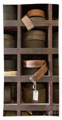 Beach Towel featuring the photograph Leather Belt Storage At An Old Mill by Edward Fielding