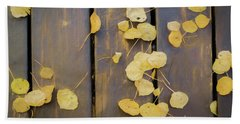 Leaves On Planks Beach Towel