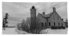 Beach Sheet featuring the photograph Lighthouse And Mackinac Bridge Winter Black And White  by John McGraw