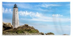 Lighthouse And Rocks Beach Towel by Dawn Romine