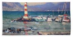 Lighthouse At Dilesi Harbor Greece Beach Towel