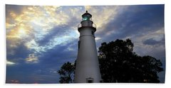 Lighthouse At Sunrise Beach Towel