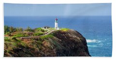Lighthouse On A Cliff Beach Towel