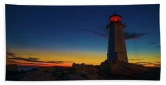 Lighthouse Sunset Beach Towel by Andre Faubert