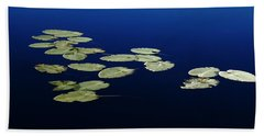 Lily Pads Floating On River Beach Towel by Debbie Oppermann