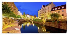 Ljubljanica River Waterfront In Ljubljana Evening View Beach Towel by Brch Photography