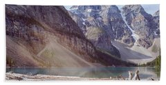 Logs At Lake Moraine Beach Towel by Patricia Hofmeester