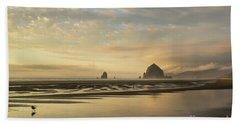 Sunset At Haystack Rock Beach Towel