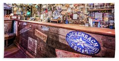 Luckenbach Bar Beach Towel by Andy Crawford