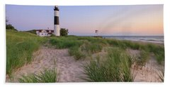 Beach Towel featuring the photograph Ludington Beach And Big Sable Point Lighthouse by Adam Romanowicz