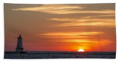 Beach Towel featuring the photograph Ludington North Breakwater Light At Sunset by Adam Romanowicz
