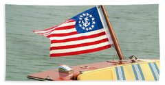 Vintage Mahogany Lyman Runabout Boat With Navy Flag Beach Towel