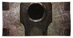 M1911 Muzzle On Rusted Riveted Metal Dark Beach Towel