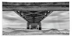 Beach Towel featuring the photograph Mackinac Bridge In Winter Underneath  by John McGraw