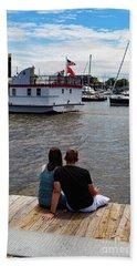 Man And Woman Sitting On Dock Beach Towel