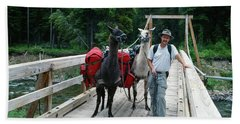 Man Posing With Two Llamas On Wilderness Drawbridge Beach Towel