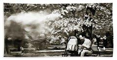 Man Strollers In The Park Beach Towel by Odon Czintos