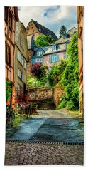 Beach Towel featuring the photograph Marburg Alley by David Morefield