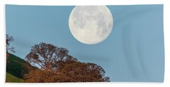 Beach Towel featuring the photograph March Moonset by Marc Crumpler