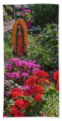Mary Among The Roses Beach Towel