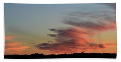 Beach Towel featuring the photograph Mauve Clouds In A Blue Sky  by Lyle Crump