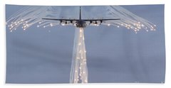 Mc-130h Combat Talon Dropping Flares Beach Towel