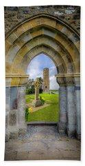 Beach Towel featuring the photograph Medieval Irish Countryside by James Truett