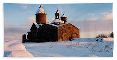Medieval Saghmosavank Monastery Covered By Snow At Sunset, Armenia Beach Towel