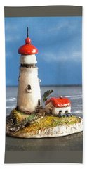 Beach Towel featuring the photograph Miniature Lighthouse by Wendy McKennon