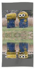 Minions In A Reflection Pool Beach Towel