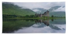 Mist Swarms Around Kilchurn Castle Beach Towel
