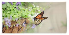 Monarch And Garden Basket Beach Towel