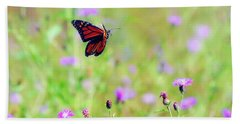 Beach Sheet featuring the photograph Monarch Butterfly In Flight Over The Wildflowers by Kerri Farley