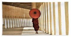 Monk With Umbrella Walking In Th Light Passway Beach Towel