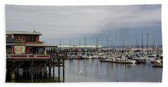 Beach Towel featuring the photograph Monterey Wharf Meets Harbor by Suzanne Luft