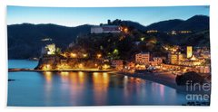 Beach Towel featuring the photograph Monterosso Al Mare At Twilight by Brian Jannsen