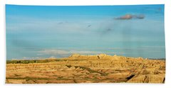 Moon Over The Badlands Beach Towel