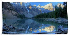 Moraine Lake Sunrise Blue Skies Logs Beach Towel