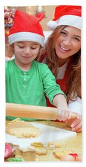 Mother With Son Doing Christmas Cookies Beach Sheet