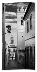 Beach Towel featuring the photograph Narrow Street And Bell Tower In Tavira - Portugal by Barry O Carroll