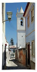 Beach Towel featuring the photograph Narrow Street In Tavira - Portugal by Barry O Carroll
