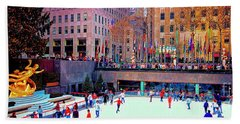 Beach Towel featuring the photograph  New York City Rockefeller Center Ice Rink  by Tom Jelen