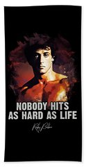 Nobody Hits As Hard As Life Beach Towel